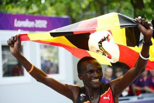 Uganda's Stephen Kiprotich waves his national flag as he celebrates winning the Olympic marathon in London on August 12. Kiprotich stunned a strong Kenyan team to win the men's Olympic marathon on Sunday, handing his east African nation only their second ever gold medal