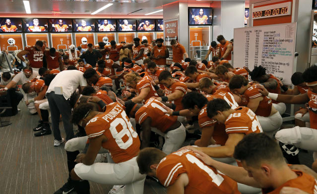 The Texas Longhorns football team prays in the locker room after the game against the LSU Tigers Saturday Sept. 7, 2019 at Darrell K Royal-Texas Memorial Stadium in Austin, Tx. LSU won 45-38. ( Photo by Edward A. Ornelas )