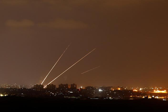 <p>Streaks of light are pictured as rockets are launched from the northern Gaza Strip towards Israel, as seen from Sderot, Israel, Aug. 8, 2018. (Photo: Amir Cohen/Reuters) </p>