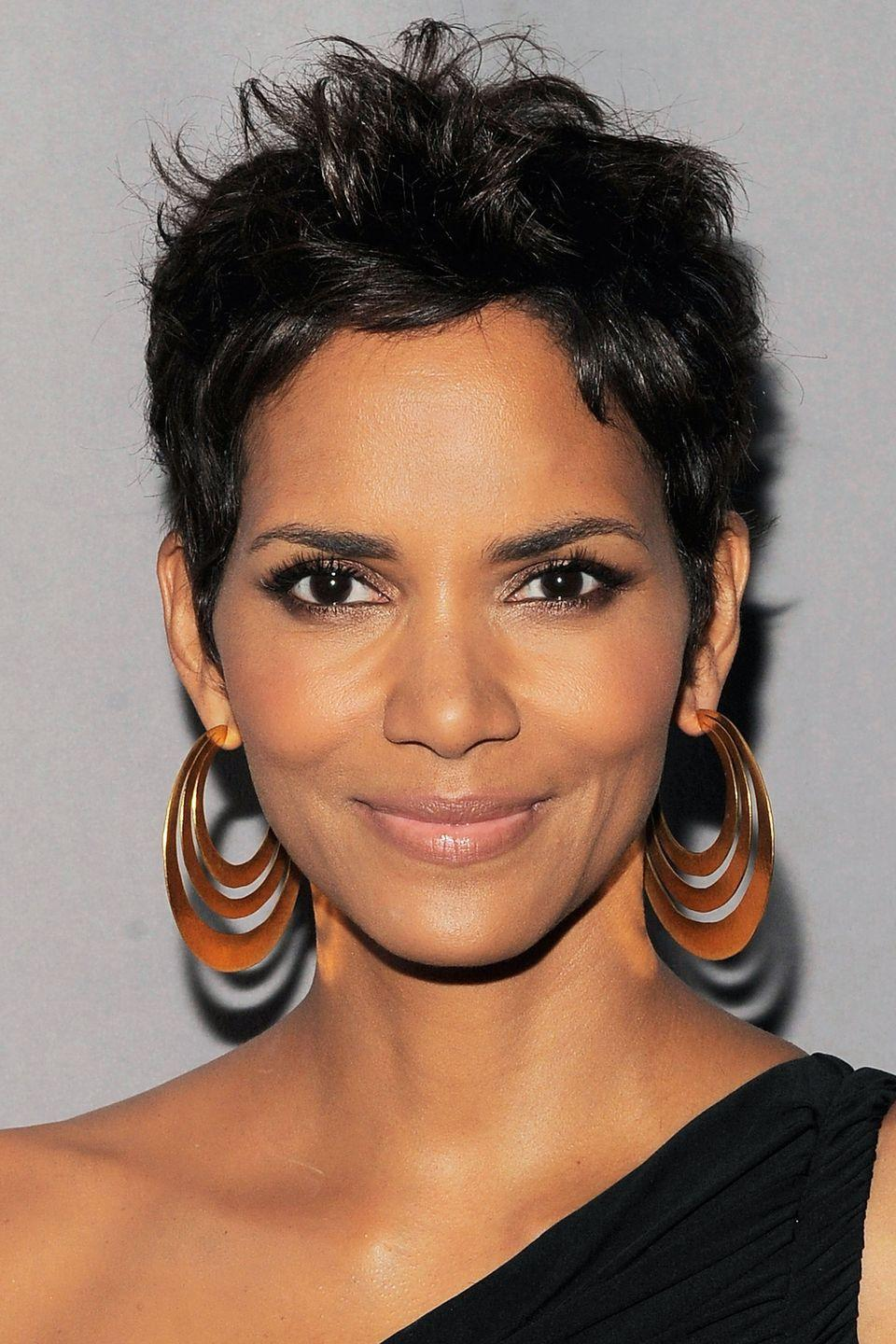 <p>Actress Halle Berry rocks her signature pixie with jet black and glossy textured pieces. </p>