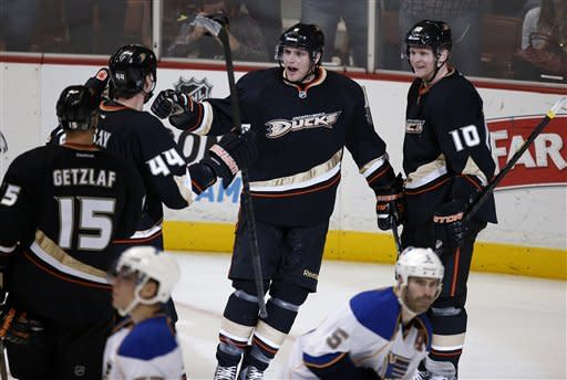 Anaheim Ducks' Bobby Ryan, center, and Corey Perry, right, celebrate a goal by Ryan with teammates during the third period of an NHL hockey game against the St. Louis Blues in Anaheim, Calif., Sunday, March 10, 2013. The Ducks won 4-2. (AP Photo/Jae C. Hong)