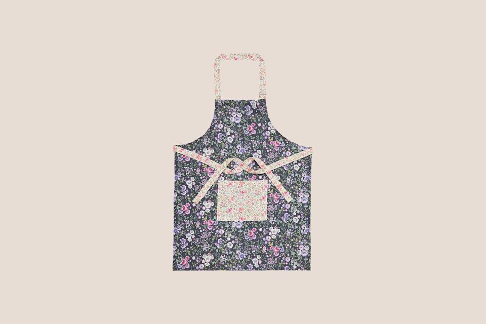 """<p>If you're a maximalist at heart, then consider an apron in a bold print. Handmade in Latvia, this eye-catching linen style features not one, but two bright floral patterns, and boasts a handy front pocket to boot.</p> <p><strong><em>Shop Now: </em></strong><em>Liberty London Delilah and Emilia's Flowers Linen Apron, $59, </em><a href=""""https://www.libertylondon.com/uk/delilah-and-emilia%E2%80%99s-flowers-linen-apron-000639218.html"""" rel=""""nofollow noopener"""" target=""""_blank"""" data-ylk=""""slk:libertylondon.com"""" class=""""link rapid-noclick-resp""""><em>libertylondon.com</em></a><em>. </em></p>"""