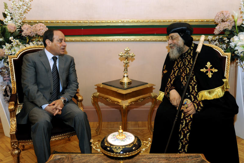Egypt's former military chief Abdel-Fattah el-Sissi, left, meets with Coptic Pope Tawadros II at Cairo's St. Mark's Cathedral, seat of the Coptic Orthodox Pope, in Cairo, Egypt, Saturday, April 19, 2014. El-Sissi on Monday took the final formal step to run in next month's presidential election, submitting to the election commission eight times the number of signatures required. He is widely expected to win. (AP Photo/Girgis Mahboub, Office of the Coptic Pope)