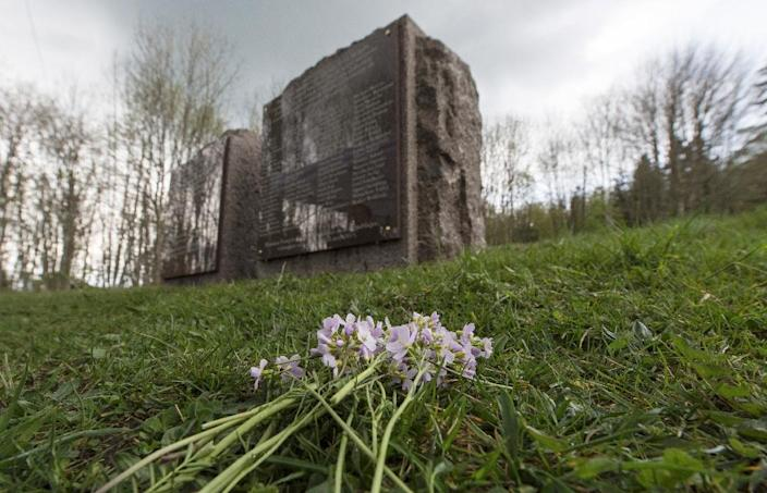 Flowers in front of a memorial stone near the gas chamber of the former Nazi concentration camp in Natzwiller-Struthof, eastern France, on April 26, 2015 (AFP Photo/Patrick Seeger)
