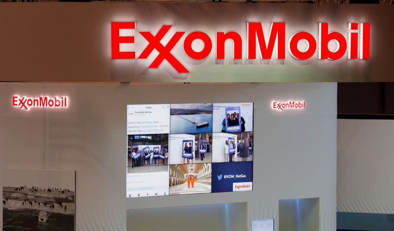 FILE PHOTO: Logos of ExxonMobil are seen in its booth at Gastech, the world's biggest expo for the gas industry, in Chiba