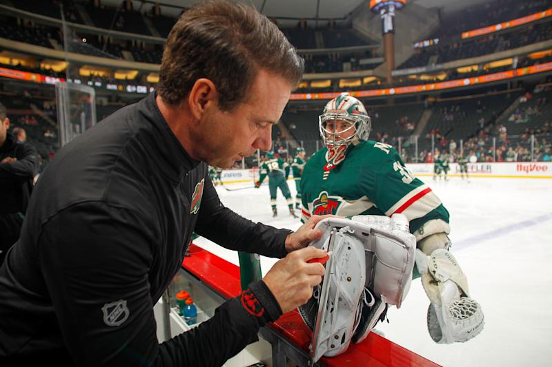 SAINT PAUL, MN - FEBRUARY 4: A member of the training staff works on the skate of Alex Stalock #32 of the Minnesota Wild prior to the game against the Chicago Blackhawks at the Xcel Energy Center on February 4, 2020 in Saint Paul, Minnesota. (Photo by Bruce Kluckhohn/NHLI via Getty Images)