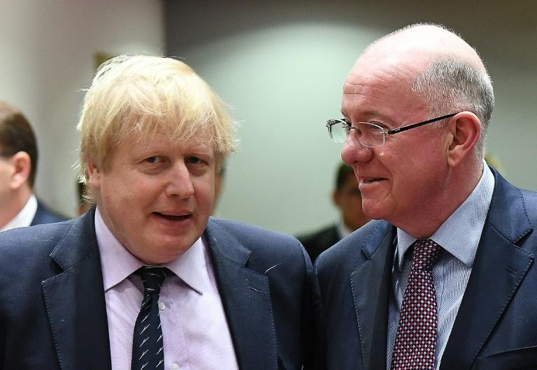 UK Foreign Secretary Boris Johnson (L) and Ireland's Foreign Minister Charlie Flanagan arrive to attend a foreign affair council at the European Council in Brussels, on March 6, 2017