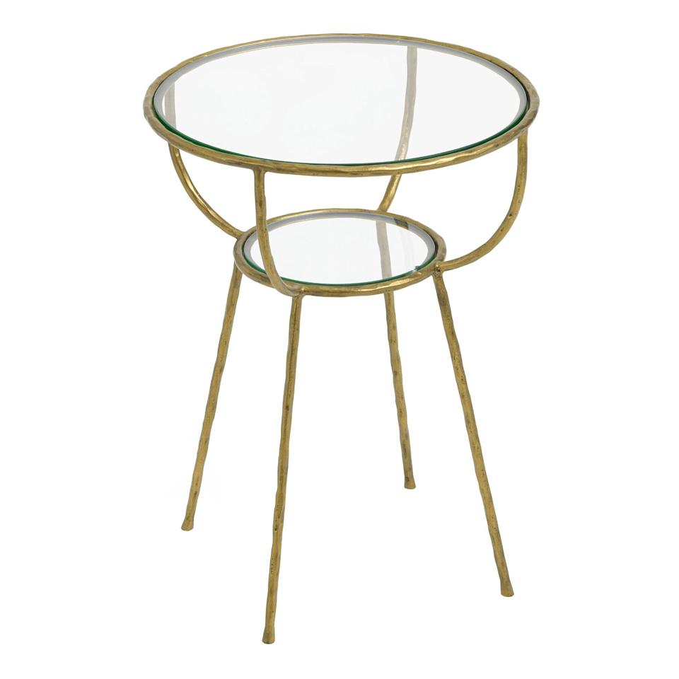 """$179.99, World Market. <a href=""""https://www.worldmarket.com/product/round-glass-and-gold-hammered-metal-hali-accent-ta.do?"""">Get it now!</a>"""