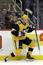 Pittsburgh Penguins' Jared McCann celebrates the first of his two goals during the second period of an NHL hockey game against the Columbus Blue Jackets in Pittsburgh, Saturday, Oct. 5, 2019. (AP Photo/Gene J. Puskar)