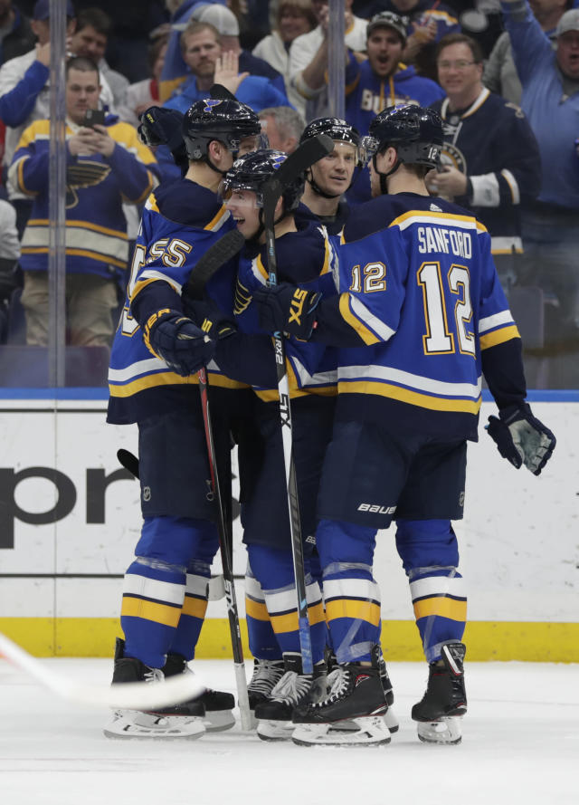 St. Louis Blues' Ivan Barbashev, center, celebrates with teammates Colton Parayko (55), Zach Sanford (12) and Jay Bouwmeester (19) after scoring a goal in the second period of an NHL hockey game against the Detroit Red Wings, Thursday, March 21, 2019, in St. Louis. (AP Photo/Tom Gannam)