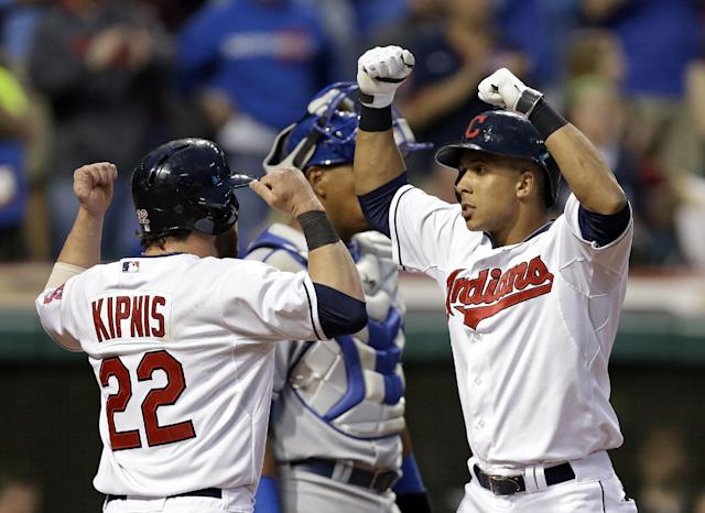 Cleveland Indians' Michael Brantley, right, celebrates his two-run home run against the Kansas City Royals with Jason Kipnis (22) in the fourth inning of a baseball game Monday, April 21, 2014, in Cleveland. (AP Photo/Mark Duncan)