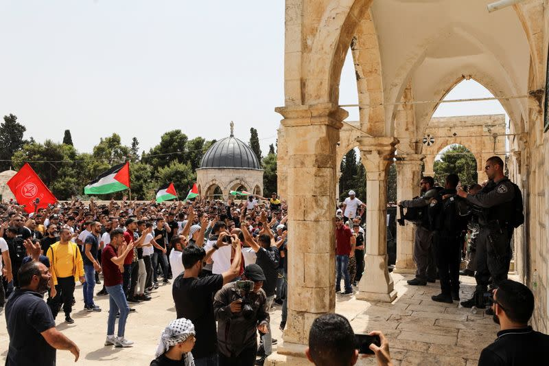 Israeli security stand in position as Palestinians protest at the compound that houses Al-Aqsa Mosque in Jerusalem's Old City