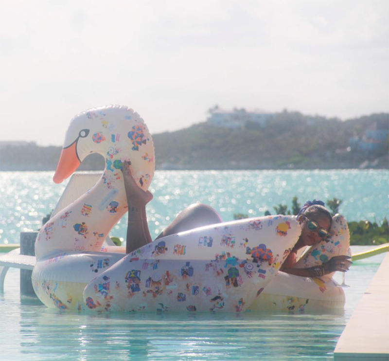 What floats Rihanna's boat? Sipping wine and catching sun aboard a swan. (Photo: Rihanna via Instagram)