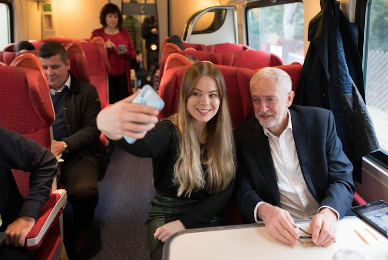 Labour Party leader Jeremy Corbyn meets a supporter on a train while on the General Election campaign trail. (PA Wire/PA Images)