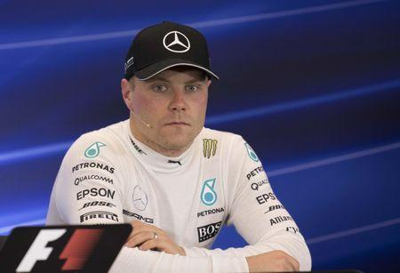 Oct 21, 2017; Austin, TX, USA; Mercedes driver Valtteri Bottas (77) of Finland is interviewed after the qualifying session for the United States Grand Prix at Circuit of the Americas. Mandatory Credit: Jerome Miron-USA TODAY Sports