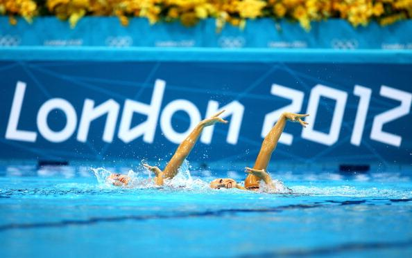 LONDON, ENGLAND - AUGUST 05:  Nadine Brandl and Livia Lang of Austria compete in the Synchronised Swimming - Duets - Technical Routine on Day 9 of the London 2012 Olympic Games at the Aquatics Centre  on August 5, 2012 in London, England.  (Photo by Al Bello/Getty Images)