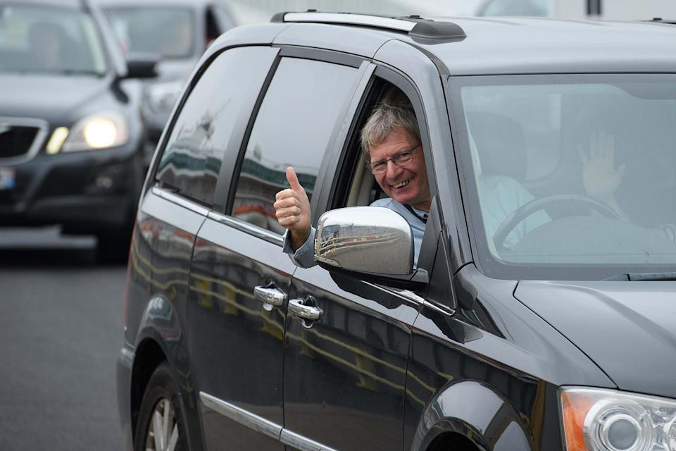 A driver gestures as vehicles disembark from a ferry in Portsmouth (Getty Images)