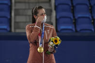 Gold medalist Belinda Bencic, of Switzerland, wipes a tear during the medal ceremony for women's singles of the tennis competition at the 2020 Summer Olympics, Sunday, Aug. 1, 2021, in Tokyo, Japan. (AP Photo/Seth Wenig)