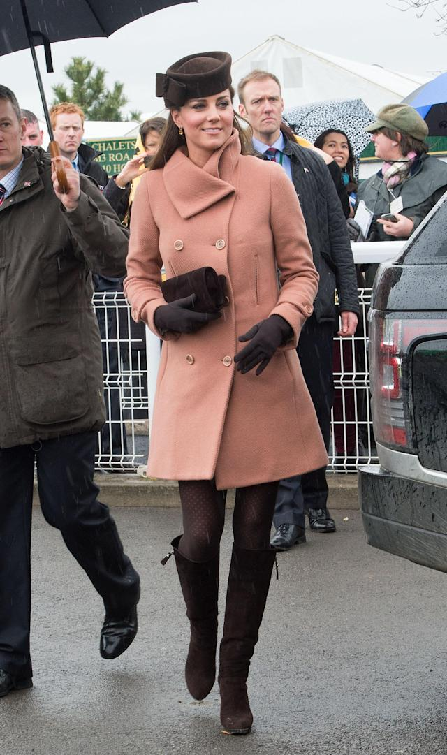 <p>Back in the days when Kate wore shorter styles, here for the 2013 Cheltenham Festival, the royal dressed in a wool Joseph coat and knee-high suede boots. (Photo: PA) </p>