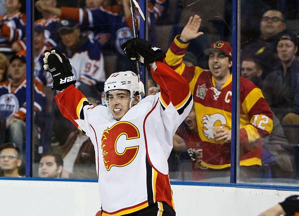 EDMONTON, AB - APRIL 2: Johnny Gaudreau #13 of the Calgary Flames celebrates a goal against the Edmonton Oilers on April 2, 2016 at Rexall Place in Edmonton, Alberta, Canada. (Photo by Codie McLachlan/Getty Images)