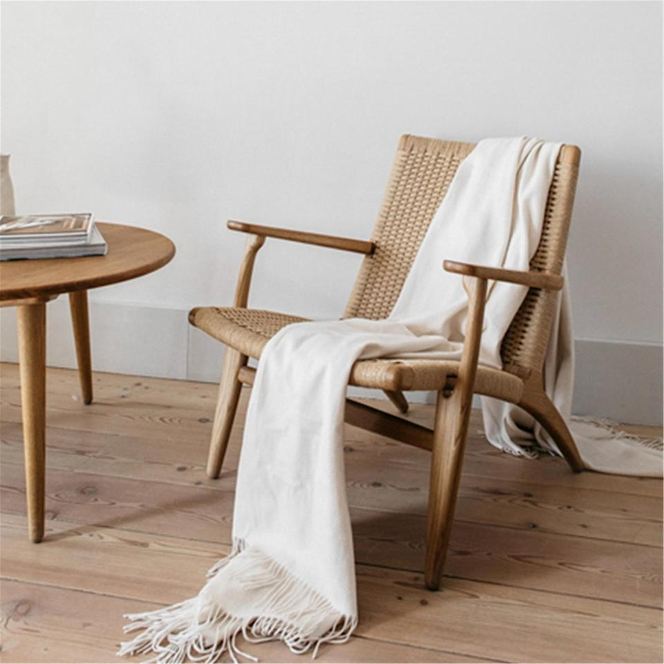 <p>This <span>Cane Chair</span> ($119) will make a great addition to your living room.</p>