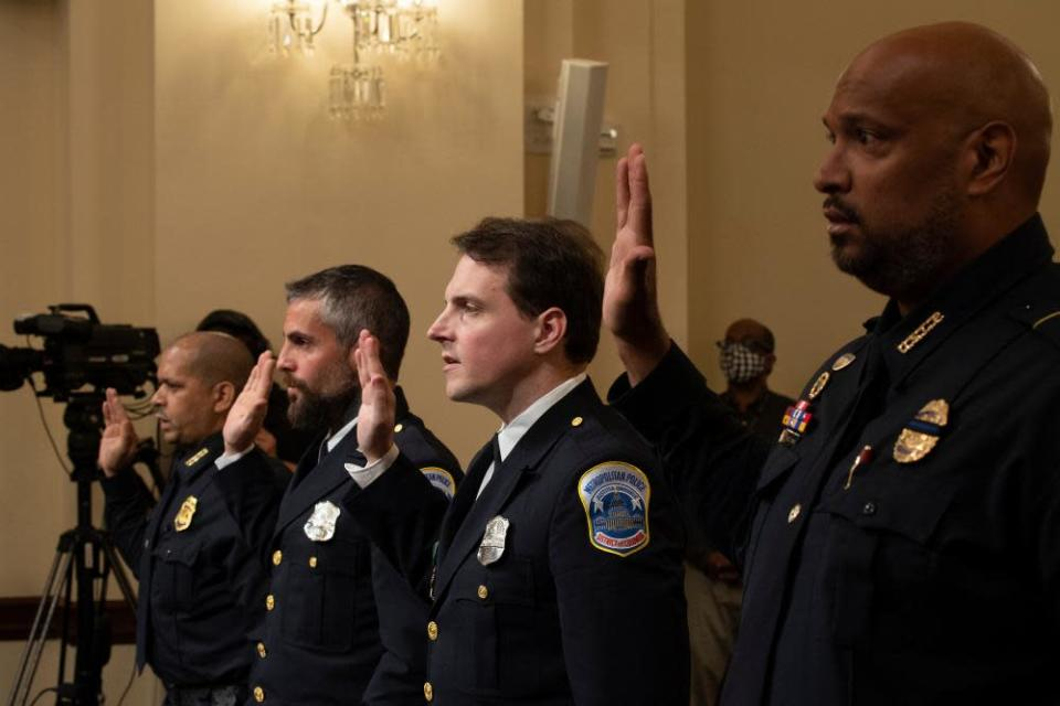 Sgt Aquilino Gonell of the US Capitol police, Michael Fanone of the Metropolitan police, Daniel Hodges of the Metropolitan police and Harry Dunn of the US Capitol Police are sworn in.
