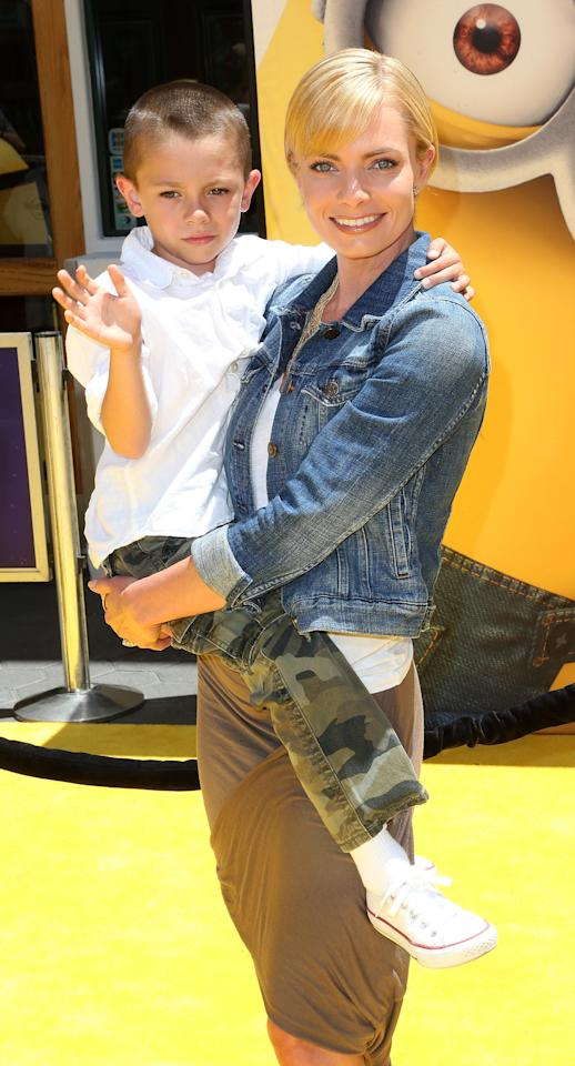 """UNIVERSAL CITY, CA - JUNE 22: Actress Jaime Pressly (R) and her son attend the premiere of Universal Pictures' """"Despicable Me 2"""" at the Gibson Amphitheatre on June 22, 2013 in Universal City, California. (Photo by Frederick M. Brown/Getty Images)"""