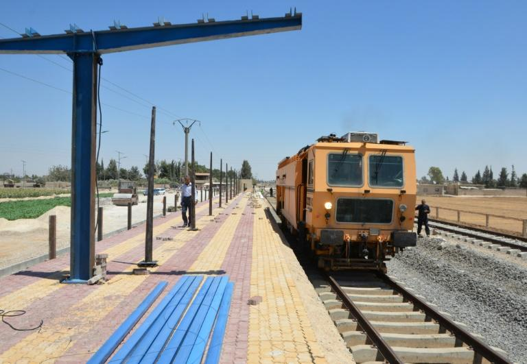 Syrian railroad workers and technicians work on the restoration of the railway in the Syrian capital Damascus. The government views reviving the railways as crucial to its reconstruction policy