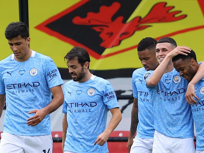 Manchester City players celebrate Sterling's second goal on Tuesday night: POOL