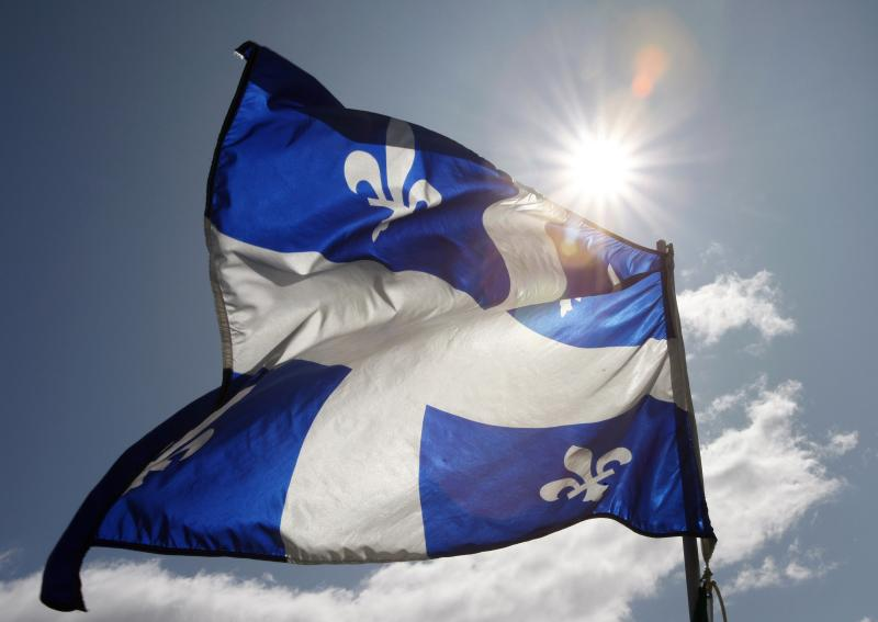 File photo of a Quebec flag flapping in the sky during the Moulin a Parole on the Plains of Abraham in Quebec City