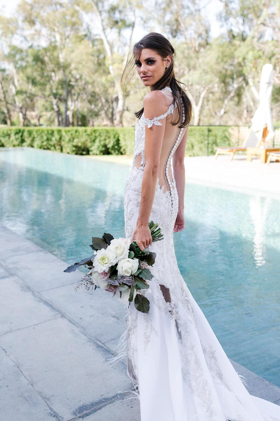 Charlotte stunned in a gorgeous bespoke Oglialoro Couture dress for her walk down the aisle. Photo: Chloe May