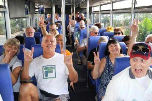 Excited passengers on a bus after disembarking from the Westerdam cruise ship in Sihanoukville, Cambodia. Source: AFP