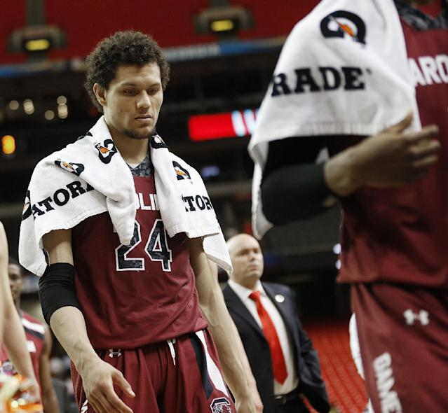 South Carolina forward Michael Carrera (24) walks off the court after the second half of an NCAA college basketball game against Tennessee in the quarterfinal round of the Southeastern Conference men's tournament, Friday, March 14, 2014, in Atlanta. Tennessee won 59-44. (AP Photo/John Bazemore)