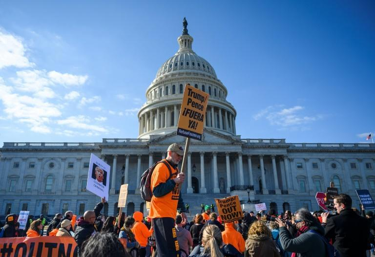 Protesters rally at the US Capitol against President Donald Trump during his impeachment trial in the Senate (AFP Photo/Andrew CABALLERO-REYNOLDS)