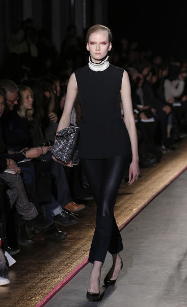 A model presents a creation by Belgium designer Cedric Charlier for his Ready to Wear Fall-Winter 2013-2014 fashion collection, in Paris, Tuesday, Feb.26, 2013. (AP Photo/Christophe Ena)
