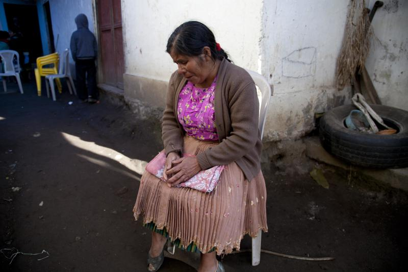 Zoila Gomez grieves outside the room where the wake is taking place for members of the Vasquez family who were buried alive when their house collapsed in San Cristobal Cucho, Guatemala, Thursday, Nov. 8, 2012. The family died when a magnitude 7.4 earthquake struck on Wednesday, collapsing the home of the Vasquez family and burying 10 of them, including a 4-year-old child, in the rubble. The quake killed at least 52 people and left dozens more missing. (AP Photo/Moises Castillo)