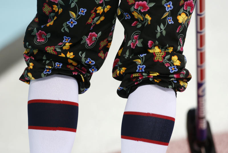 A Norwegian curler wears rose-painting knickers during curling training at the 2014 Winter Olympics, Saturday, Feb. 8, 2014, in Sochi, Russia. (AP Photo/Robert F. Bukaty)