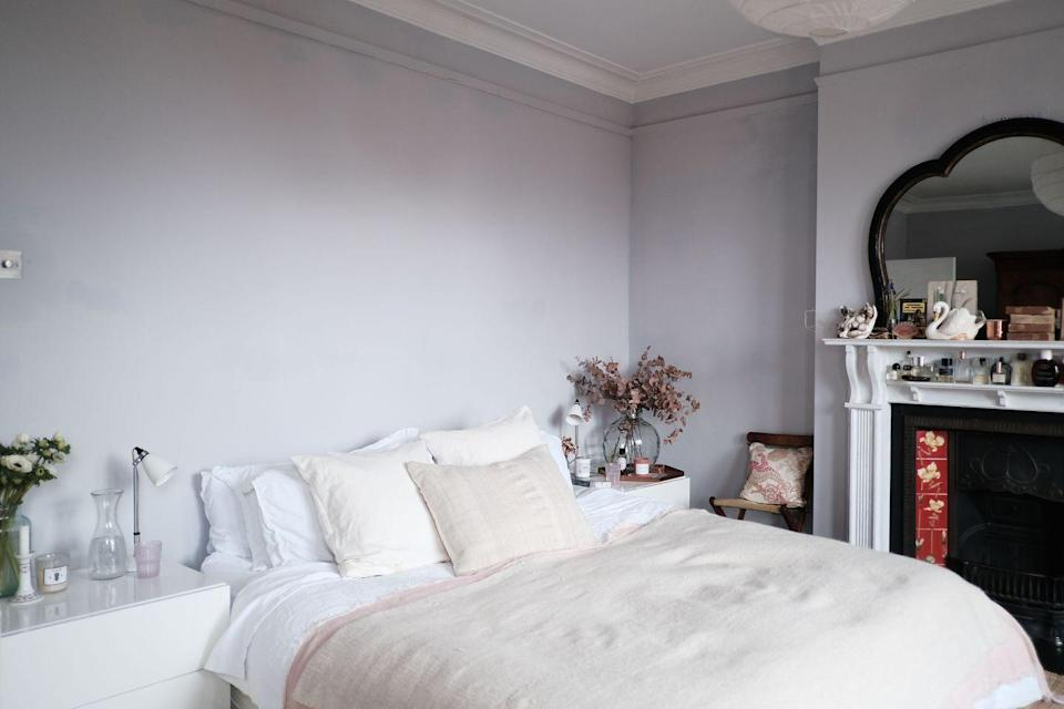 """<p>""""We like our bedroom to be peaceful and calming, so we used a muted colour palette,"""" says Charlotte. """"We really like the wall behind the bed being free from art and without a headboard because it always gets the most amazing pink and orange light show every evening when the sun sets - it allows the blank wall to be spectacular. The reading lights are by one of our favourite lighting suppliers <a href=""""https://www.originalbtc.com/ccrz__HomePage?cclcl=en_GB&country=United+Kingdom&gclid=Cj0KCQiA34OBBhCcARIsAG32uvNFF7OPqjFpC8TUJgxmvzKoowoLQGlB7xH7paaw3ikfZi9ebr8Ff80aAi7WEALw_wcB"""" rel=""""nofollow noopener"""" target=""""_blank"""" data-ylk=""""slk:Original BTC"""" class=""""link rapid-noclick-resp"""">Original BTC</a>. We've had them for years; they've followed us to three houses so far. Since lockdown, we've been treating ourselves to weekly fresh flowers in the bedroom which are a real mood enhancer.""""</p>"""