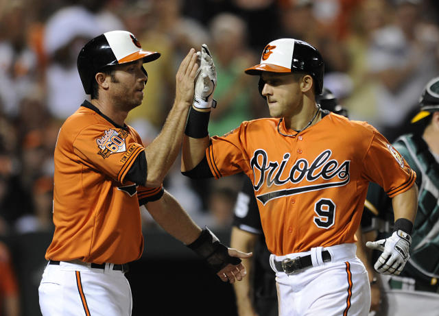 Baltimore Orioles' J.J. Hardy, left, congratulates David Lough on his two-run home run against the Oakland Athletics in the sixth inning of a baseball game Saturday, June 7, 2014, in Baltimore. The Orioles won 6-3. (AP Photo/Gail Burton)