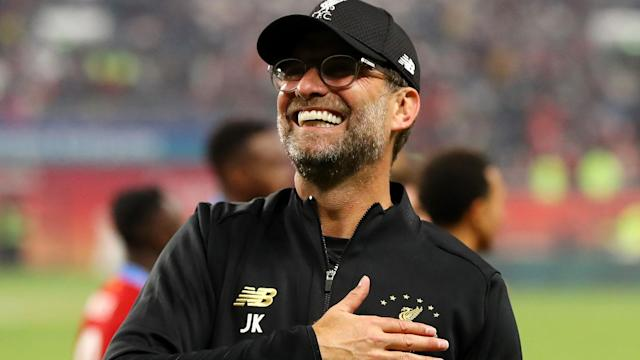 Don Hutchison believes Jurgen Klopp's side have one hand on the Premier League title, with Champions League and FA Cup crowns back on the agenda