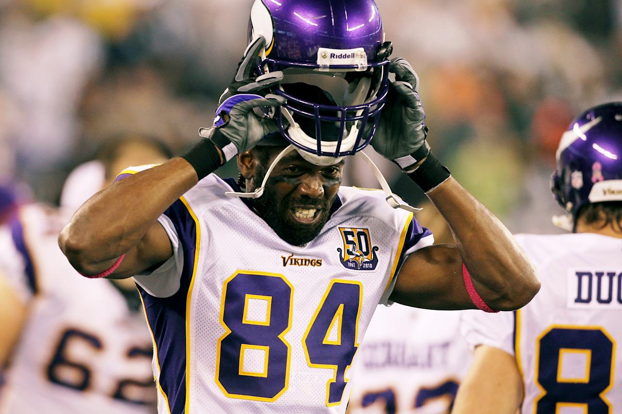 EAST RUTHERFORD, NJ - FILE:  Randy Moss #84 of the Minnesota Vikings adjusts his helmet against the New York Jets at New Meadowlands Stadium on October 11, 2010 in East Rutherford, New Jersey.  It was announced by his agent that WR Randy Moss has decided to retire from football August 1, 2011.  (Photo by Jim McIsaac/Getty Images)