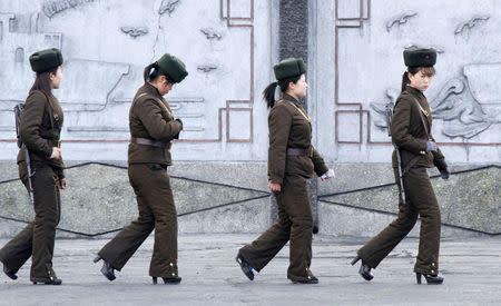 Female North Korean soldiers patrol along the banks of Yalu River, near the North Korean town of Sinuiju, opposite the Chinese border city of Dandong. REUTERS/Jacky Chen
