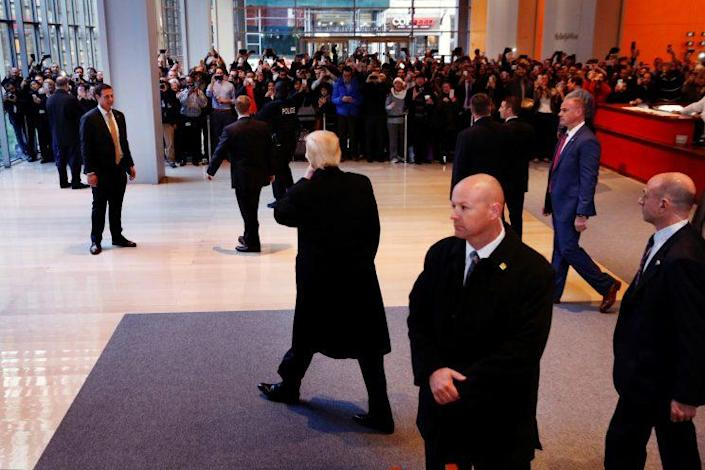 Donald Trump waves as he departs the lobby of the New York Times building. (Photo: Lucas Jackson/Reuters)