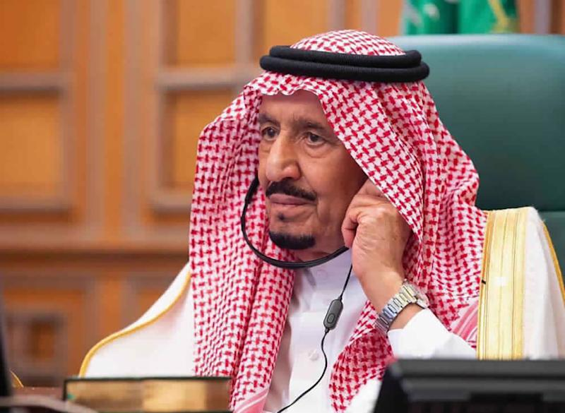 In this photo released by Saudi Press Agency, SPA, Saudi King Salman, chairs a video call of world leaders from the Group of 20 and other international bodies and organizations, from his office in Riyadh, Saudi Arabia, Thursday, March 26, 2020. The online meeting, that lasted about 90 minutes, aimed at coordinating the global response to the fast-spreading coronavirus, which has shuttered businesses and forced well over a quarter of the world's population into home isolation. (Saudi Press Agency via AP)