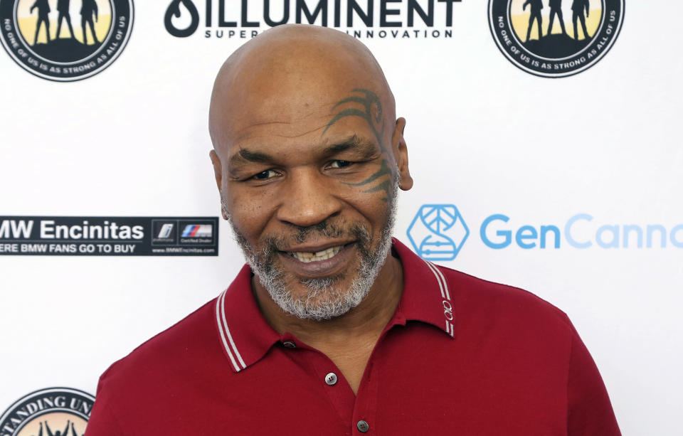 FILE - In this Aug. 2, 2019, file photo, Mike Tyson attends a celebrity golf tournament in Dana Point, Calif. Tyson and Roy Jones Jr. are older, wiser, calmer men than the superstars who dominated their sport. Their fight at Staples Center on Saturday night, Nov. 28, is an eight-round exhibition bout with no official judging and limited violence, although the limit depends on whether you're asking the fighters or the California State Athletic Commission. For Tyson and Jones, this unique pay-per-view boxing match is less of a sporting event and more of a chance for two transcendent athletes to prove age is a number and aging is a choice. (Photo by Willy Sanjuan/Invision/AP, File)