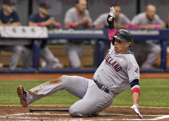 Cleveland Indians' Asdrubal Cabrera scores on Nyjer Morgan's RBI-single during the second inning of a baseball game against the Tampa Bay Rays, Sunday, May 11, 2014, in St. Petersburg, Fla. (AP Photo/Steve Nesius)