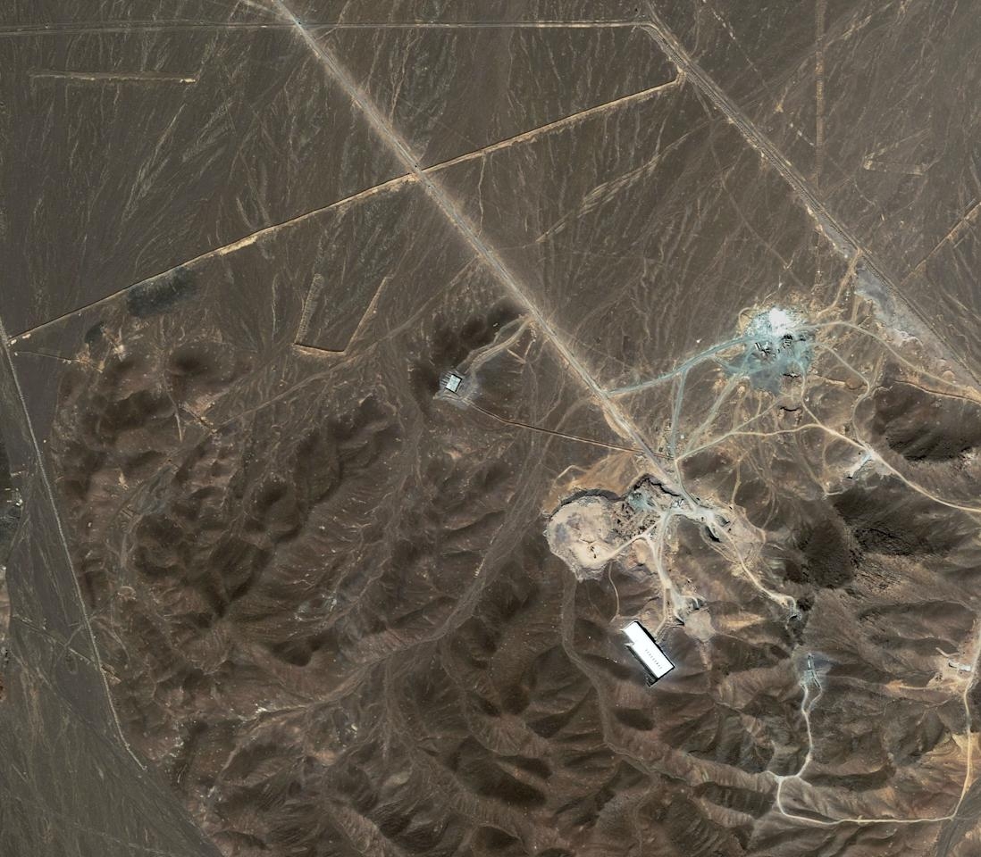FILE -A file satellite image taken Sunday Sept. 27, 2009, provided by DigitalGlobe, shows a suspected nuclear enrichment facility under construction inside a mountain located north of Qom, Iran. The Washington-based Institute for Science and International Security, which has closely followed Iranian nuclear developments, says it believes this satellite photo of a site on a military base near Qom, Iran, is most likely the location of the newly revealed centrifuge facility. (AP Photo/DigitalGlobe, File)