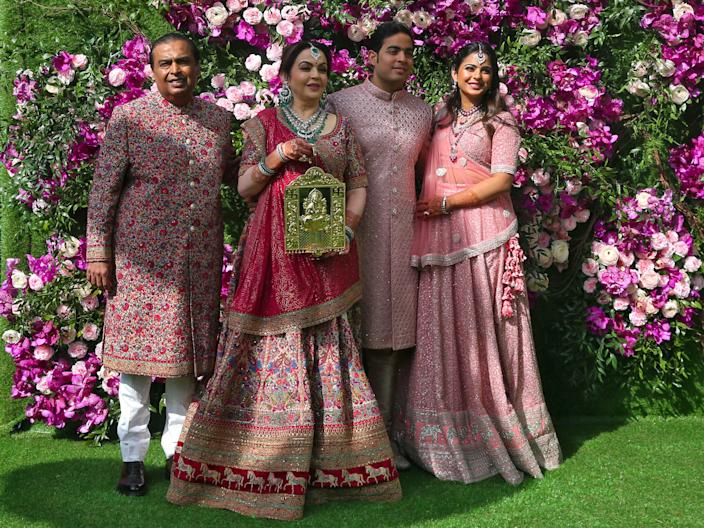 Mukesh Ambani, the Chairman of Reliance Industries, from left, his wife, Nita Ambani, their son Akash Ambani, and daughter Isha Piramal.