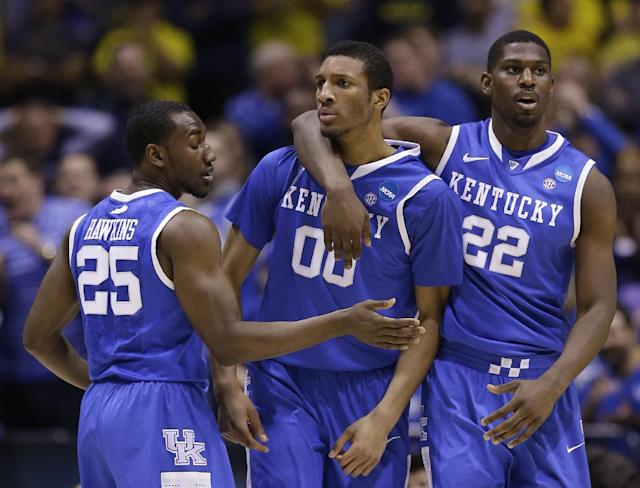 Kentucky's Alex Poythress (22), Marcus Lee (00) and Dominique Hawkins (25) celebrate during the second half of an NCAA Midwest Regional final college basketball tournament game against Michigan Sunday, March 30, 2014, in Indianapolis. (AP Photo/David J. Phillip)