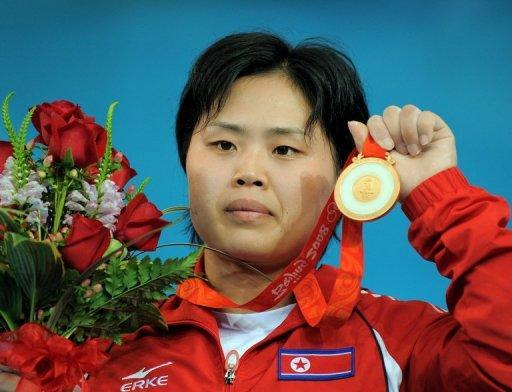 """Pak Hyon-Suk of North Korea poses during the awarding ceremony for the women's 63kg weightlifting event at the 2008 Beijing Olympic Games. When Pak clinched the gold at the games, she heaped praise on Kim Jong-Il, who was known as the """"Dear Leader"""" or """"Dear General."""""""